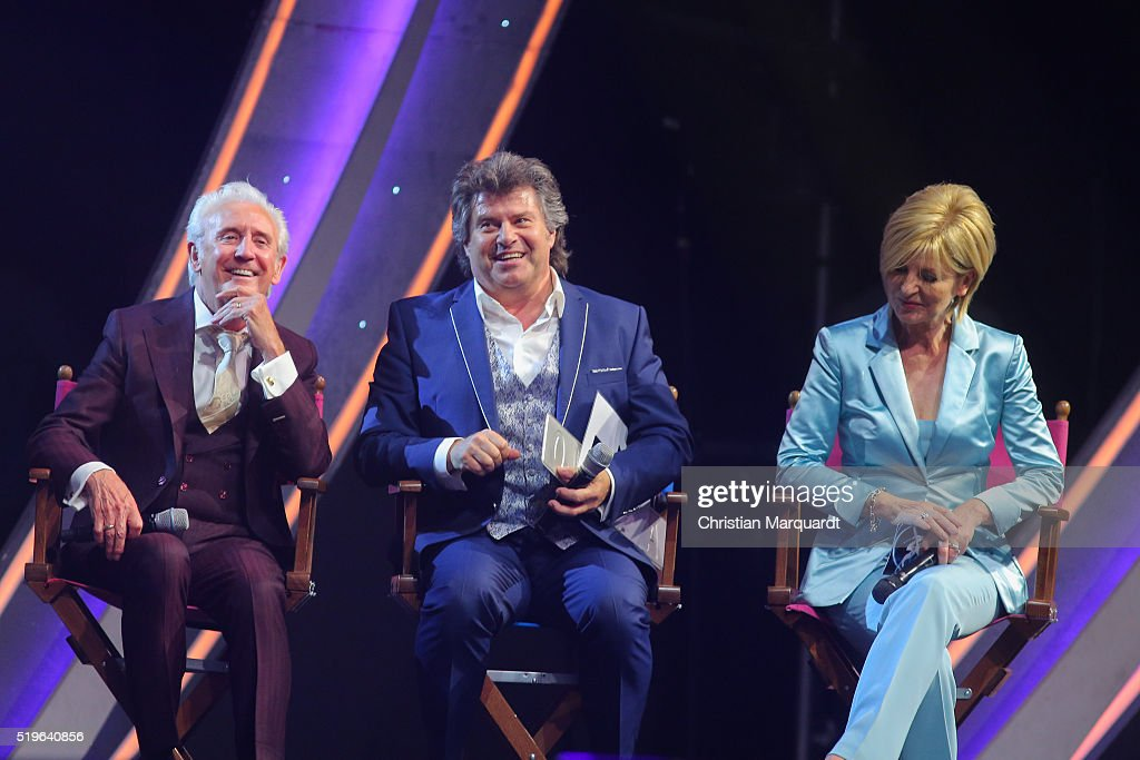 L-R) Tony Christie, Andy Borg and Camren Nebel on stage during the tv show 'Willkommen bei Carmen Nebel' at Tempodrom on April 7, 2016 in Berlin, Germany.