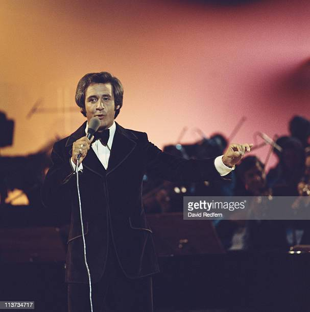 Tony Christie British singer singing into a microphone during the filming of a show at BBC Television Centre London England Great Britain circa 1970