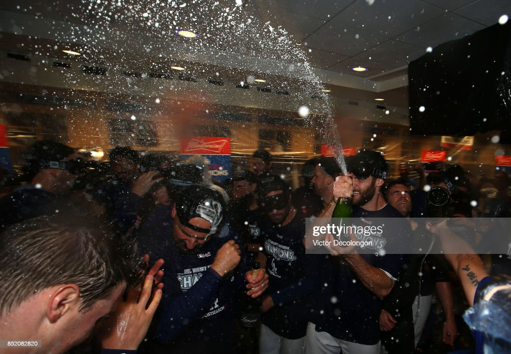 Tony Cingrani #54 of the Los Angeles Dodgers sprays champagne in the clubhouse after their 4-2 win a MLB game against the San Francisco Giants to clinch their fifth consecutive National League West Division title at Dodger Stadium on September 22, 2017 in Los Angeles, California.