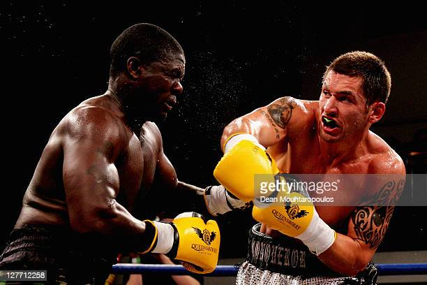 Tony Conquest of Romford lands a blow on Hastings Rasani of Birmingham during the Cruiserweight contest held at York Hall on September 30 2011 in...