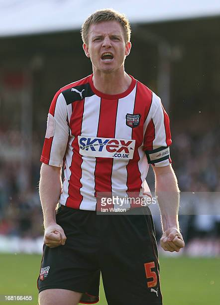 Tony Craig of Brentford celebrates after scoring a penalty in the npower League One Play Off Semi Final, Second Leg match between Brentford and...