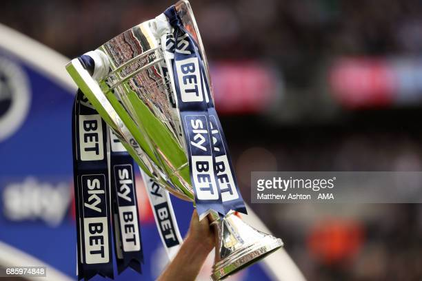 Tony Craig of Millwall holds up the trophy during the Sky Bet League One Playoff Final between Bradford City and Millwall at Wembley Stadium on May...