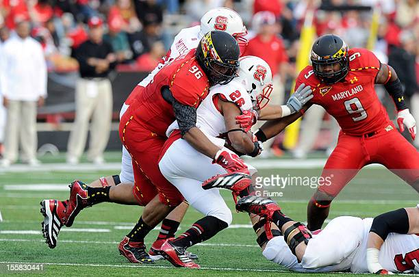 Tony Creecy of the North Carolina State Wolfpack is tackled by AJ Francis of the Maryland Terrapins at Byrd Stadium on October 20 2012 in College...