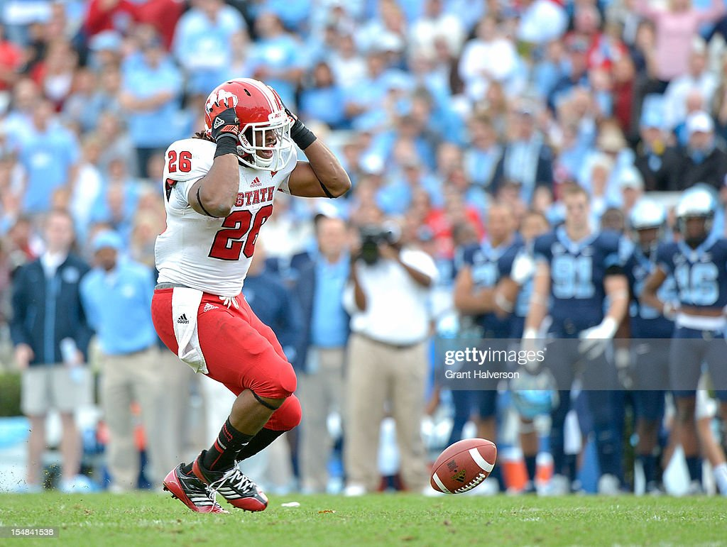 Tony Creecy #26 of the North Carolina State Wolfpack reacts after dropping a pass in the open field against the North Carolina Tar Heels during play at Kenan Stadium on October 27, 2012 in Chapel Hill, North Carolina. North Carolina won 43-35.