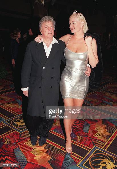 Tony Curtis and his friend Jill Vandenberg arrive ...