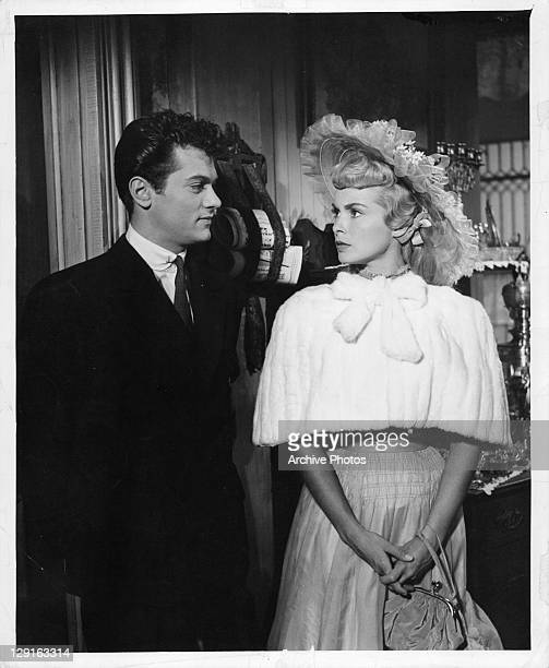 Tony Curtis and Janet Leigh all dressed up in a scene from the film 'Houdini' 1953