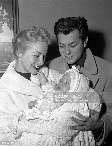 Tony Curtis and Janet leigh with their 6 month old daughter Kelly Lee at International Airport.