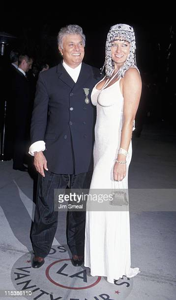 Tony Curtis and Jill Vandenberg during 1999 Vanity Fair Oscar Party Arrivals at Morton's Restaurant in Los Angeles California United States