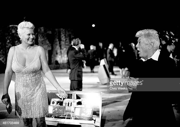Tony Curtis and wife Jill Vandenberg during 2004 Vanity Fair Oscar Party Arrival Black White Photography by Chris Weeks at Morton's in Beverly Hills...