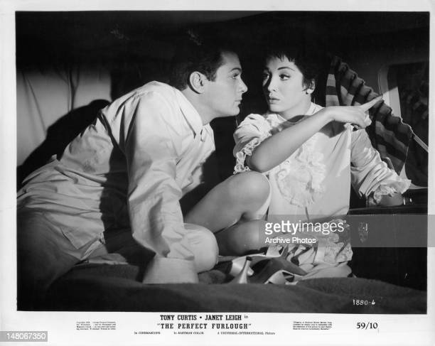 Tony Curtis getting up close to Linda Cristal in a scene from the film 'The Perfect Furlough' 1958
