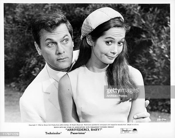 Tony Curtis holding Nancy Kwan in a scene from the film 'Arrivederci Baby' 1967