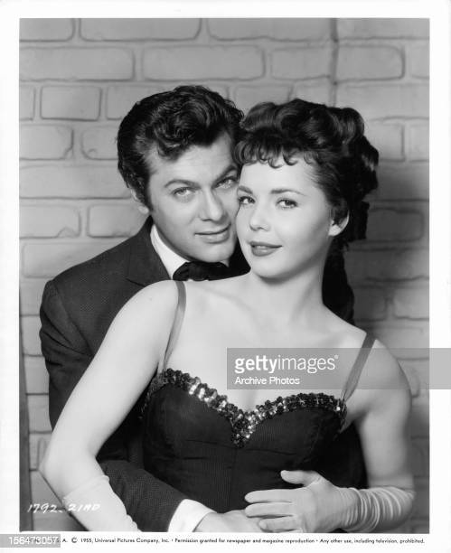 Tony Curtis holds Colleen Miller in publicity portrait for the film 'The Rawhide Years' 1955