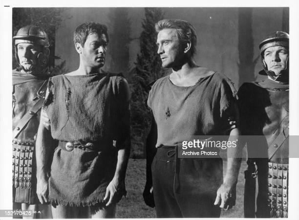 Tony Curtis looking over at Kirk Douglas in a scene from the film 'Spartacus' 1960