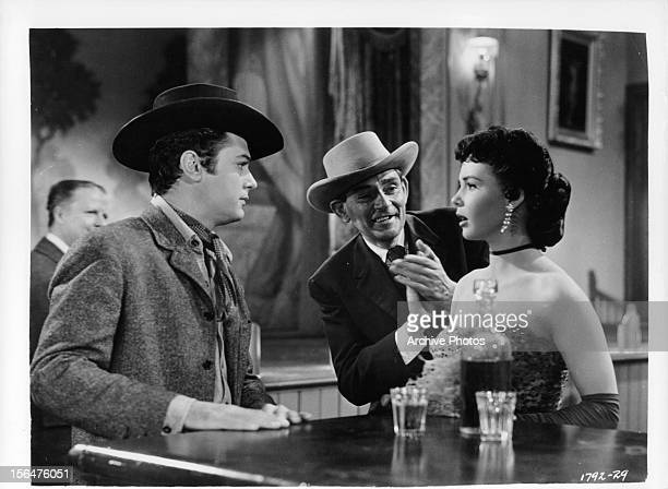 Tony Curtis meets Colleen Miller at a bar in a scene from the film 'The Rawhide Years' 1955