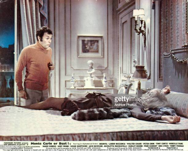 Tony Curtis reacting to Mireille Darc on the bed in a scene from the film 'Those Daring Young Men in Their Jaunty Jalopies', 1969.