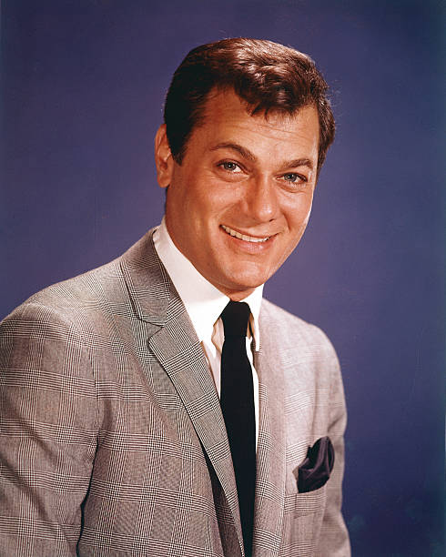 tony-curtis-us-actor-smiling-wearing-a-g