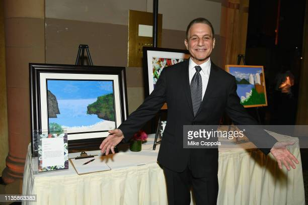 Tony Danza poses with art that will be auctioned at the 2019 2nd Annual ADAPT Leadership Awards at Cipriani 42nd Street on March 14 2019 in New York...