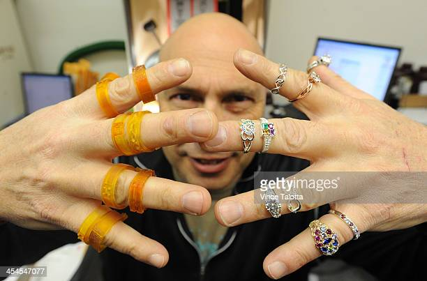 TORONTO ON DECEMBER 6 Tony Davis CEO at Jewlrcom displays 3d printed wax jewelry on one hand and the finished product silver and gold jewelry pieces...