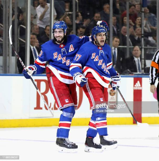 Tony DeAngelo of the New York Rangers celebrates his hattrick goal on the powerplay at 1502 of the 2 against the New Jersey Devils and is joined by...