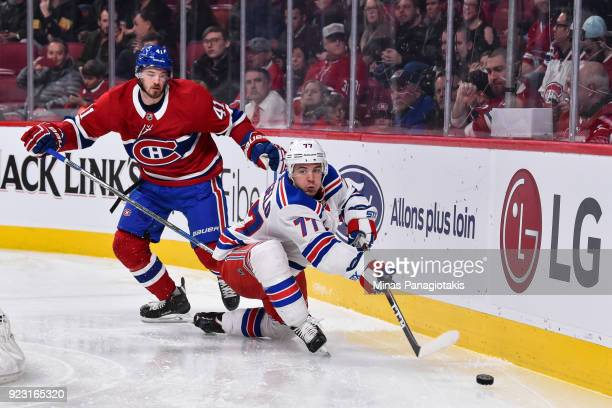 Tony DeAngelo of the New York Rangers defends the puck against Paul Byron of the Montreal Canadiens during the NHL game at the Bell Centre on...