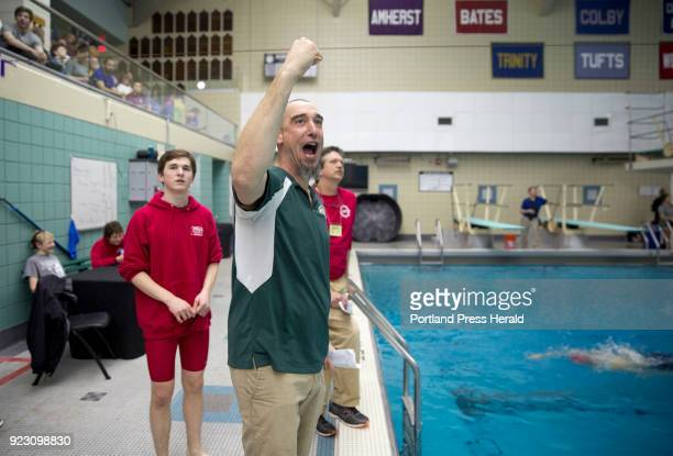 Tony DeMuro the head coach of Mount Desert Island's boys swim team cheers his team on during the Boys Class B state swimming and diving championship...