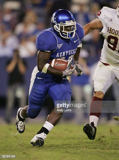 Tony Dixon of the Kentucky Wildcats carries the ball during the game against the Indiana Hoosiers on September 18 2004 at Commonwealth Stadium in...