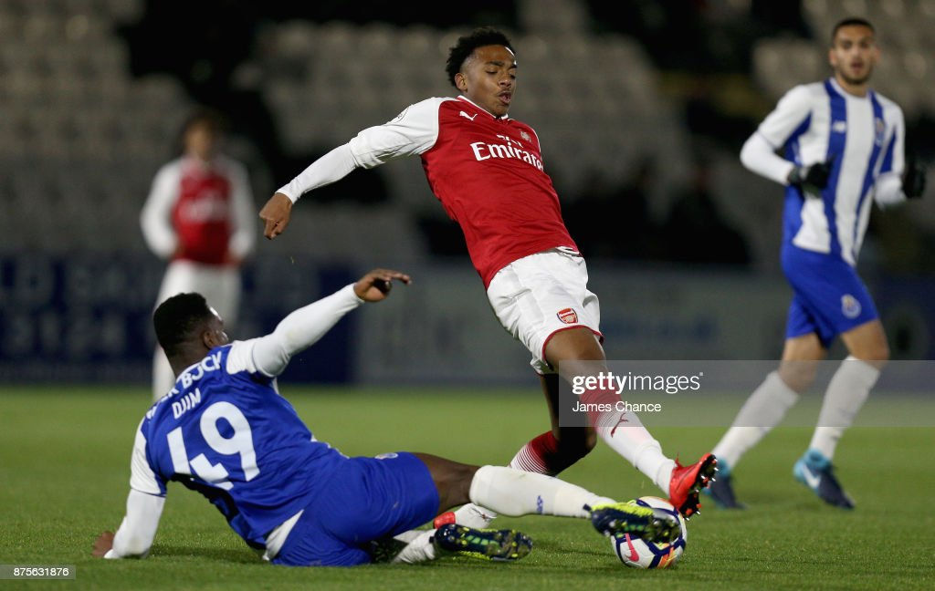 Tony Djim of Porto tackles Joseph Willock of Arsenal during the Premier League International Cup match between Arsenal and Porto at Meadow Park on November 17, 2017 in Borehamwood, England.