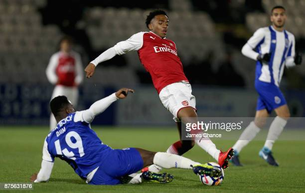 Tony Djim of Porto tackles Joseph Willock of Arsenal during the Premier League International Cup match between Arsenal and Porto at Meadow Park on...