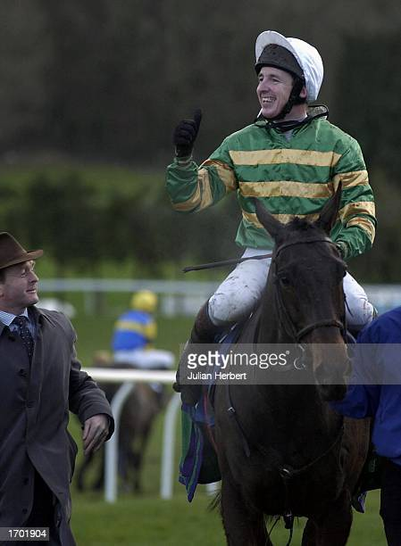 Tony Dobbin and Mini Sensation return after landing The Coral Welsh National Race run at Chepstow Racecourse on December 27, 2002 in Chepstow.