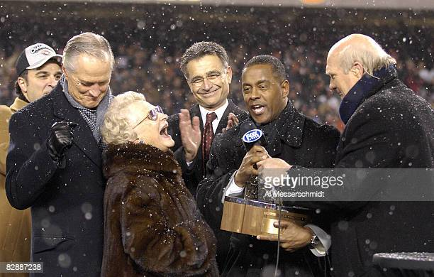 Tony Dorsett presents the George S Halas trophy to Virginia McCaskey and Michael McCaskey after the Bears won the 2007 NFC Championship game between...