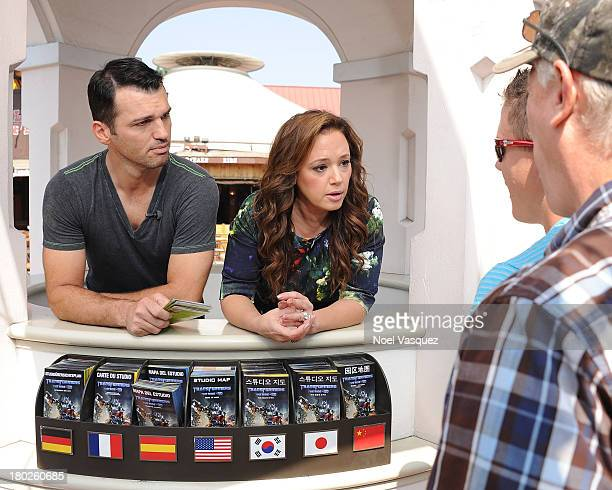 Tony Dovolani and Leah Remini work at the Information Booth at Universal Studios Hollywood on September 10 2013 in Universal City California