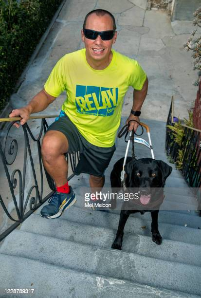 Tony Duenas a blind marathon runner, is photographed with his guide dog Diana, a 7 year old Black Labrador Retriever, outside his home in Los Angeles.