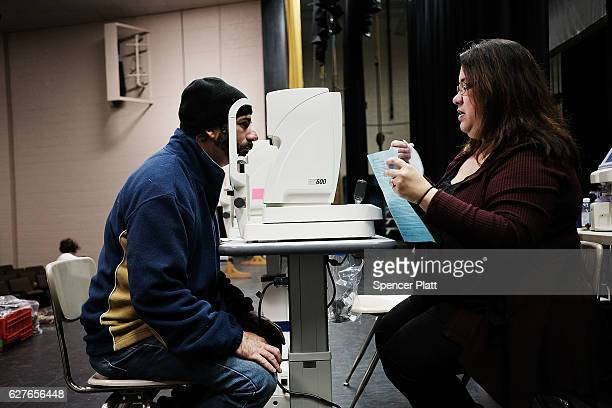 Tony Eldridge is given an eye exam at a vision clinic at the Remote Area Medical mobile dental and medical clinic on December 4 2016 in Milton...