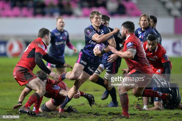 Tony Ensor of Stade Francais is tackled during the European Rugby Challenge Cup match between Stade Francais and Edinburgh at Stade JeanBouin on...
