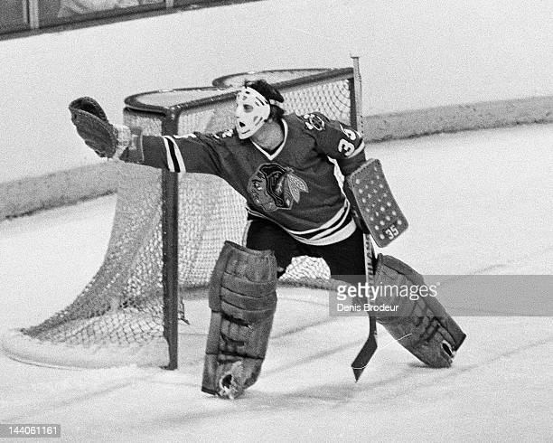 Tony Esposito of the Chicago Blackhawks makes a glove save during a game against the Montreal Canadiens Circa 1977 at the Montreal Forum in Montreal...
