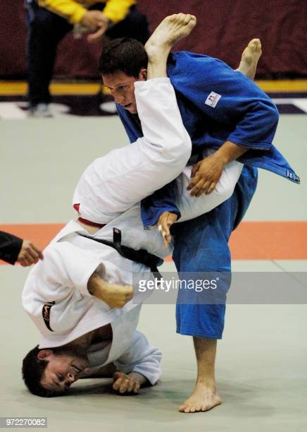 Tony Esposito of the US is upended by Luis Lopez of Venuzuela during a preliminary rounds of the 100 kg category during the 2001 Pacific Rim Judo...