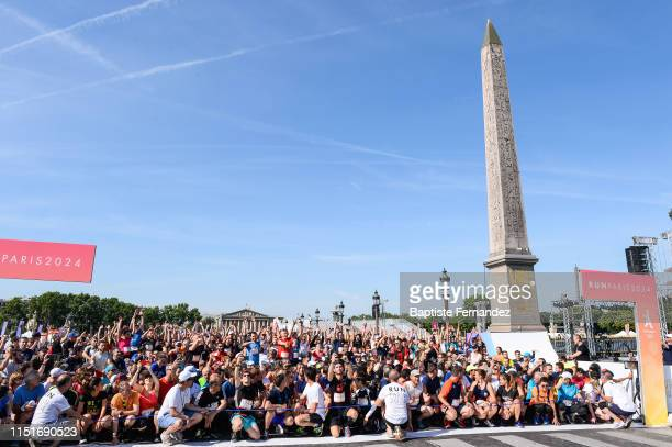 Tony Estanguet and runners who are gonna take part of Run Paris 2024 at Place de la concorde which has been turned into a giant Olympic park ahead of...