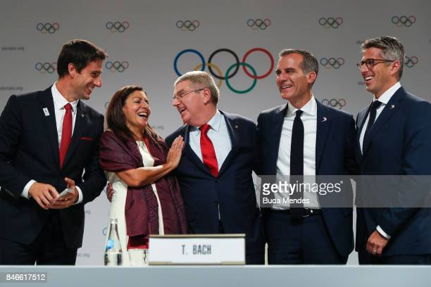 Tony Estanguet Anne Hidalgo Thomas Bach Eric Garcetti and Casey Wasserman pose for pictures during a joint press conference between IOC Paris 2024...
