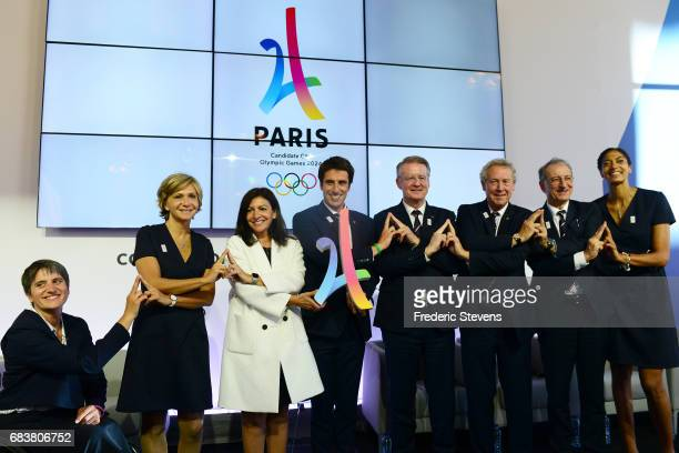 Tony Estanguet cochairman of the Paris 2024 Organising Committee poses for photographers with Paralympic Committee president Emmanuelle Assmann Ile...