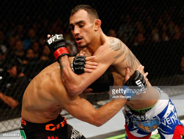 Tony Ferguson attempts to secure a darce choke against Danny Castillo in their lightweight bout during the UFC 177 event at Sleep Train Arena on...