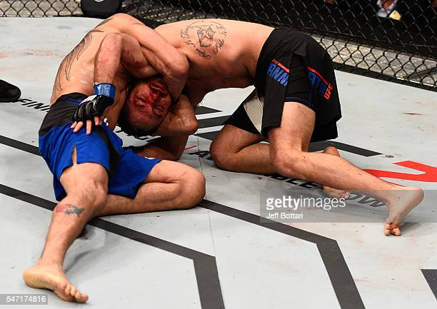 Tony Ferguson attempts to submit Lando Vannat in their lightweight bout during the UFC Fight Night event on July 13 2016 at Denny Sanford Premier...