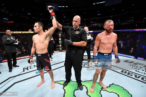 Tony Ferguson celebrates his victory over Donald Cerrone in their lightweight bout during the UFC 238 event at the United Center on June 8 2019 in...