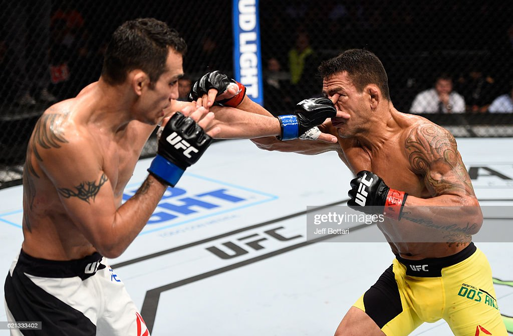 Tony Ferguson of the United States accidentally pokes the eye of Rafael Dos Anjos of Brazil in their lightweight bout during the UFC Fight Night event at Arena Ciudad de Mexico on November 5, 2016 in Mexico City, Mexico.