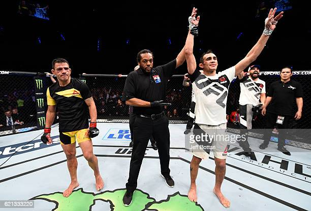 Tony Ferguson of the United States celebrates his victory over Rafael Dos Anjos of Brazil in their lightweight bout during the UFC Fight Night event...