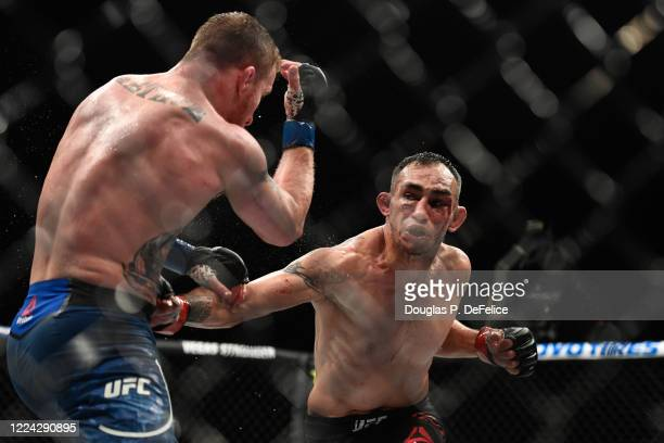 Tony Ferguson of the United States looks to punch Justin Gaethje of the United States in their Interim lightweight title fight during UFC 249 at...
