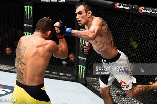 Tony Ferguson of the United States punches Rafael Dos Anjos of Brazil in their lightweight bout during the UFC Fight Night event at Arena Ciudad de...