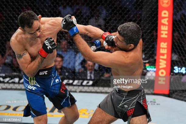 Tony Ferguson punches Beneil Dariush in their lightweight bout during the UFC 262 event at Toyota Center on May 15, 2021 in Houston, Texas.