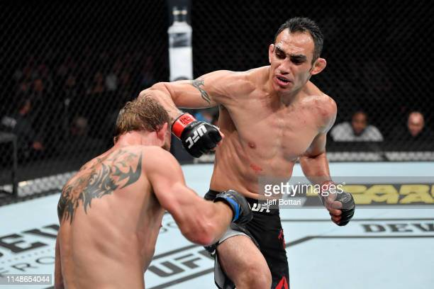 Tony Ferguson punches Donald Cerrone in their lightweight bout during the UFC 238 event at the United Center on June 8 2019 in Chicago Illinois