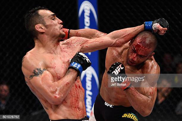 Tony Ferguson punches Edson Barboza in their lightweight bout during the TUF Finale event inside The Chelsea at The Cosmopolitan of Las Vegas on...