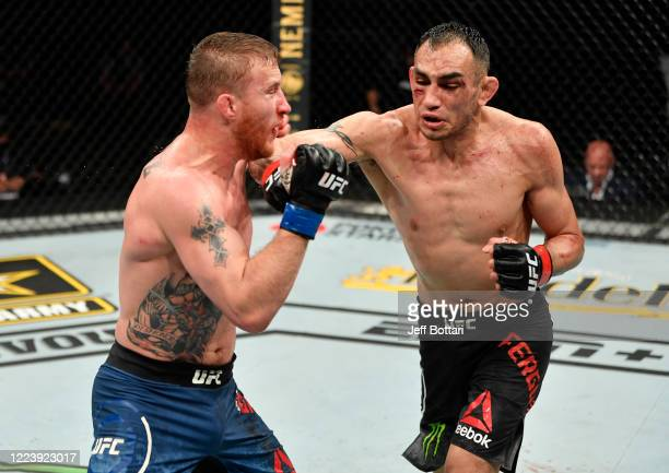 Tony Ferguson punches Justin Gaethje in their UFC interim lightweight championship fight during the UFC 249 event at VyStar Veterans Memorial Arena...